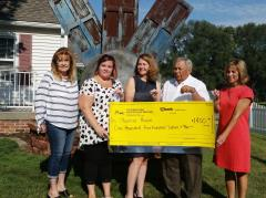 Diane McKee is presented with a Check to The Phoenix House
