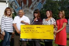 Members of the Golf Bash Committee presents a check to Jenny Schroeder - Make-A-Wish Iowa