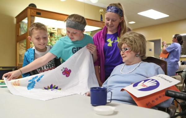 Lewis Central 5th Graders Pay It Forward with decorated pillowcases to residents of Northcrest Living Center